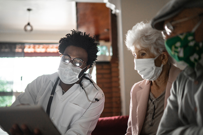 Doctor seeing patients in their home
