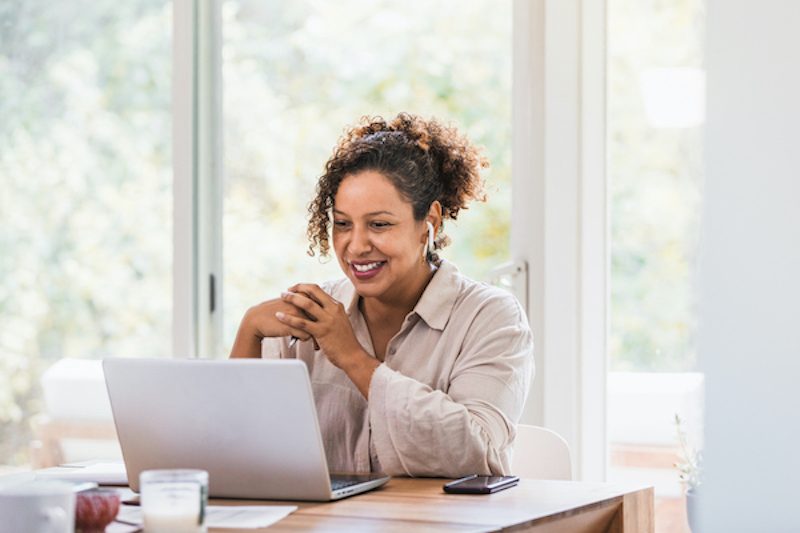 Woman advising remotely via computer