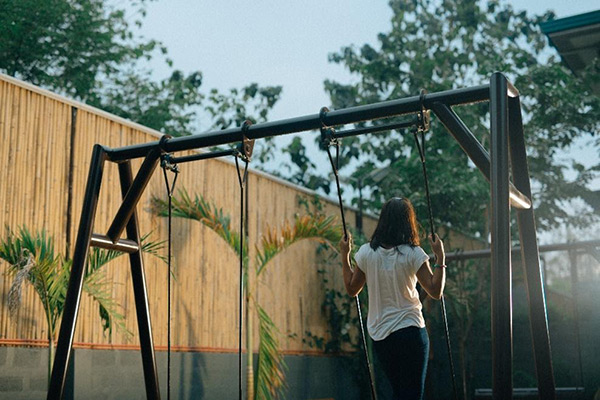 Girl swinging on playground