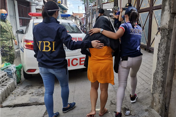 Woman being arrested in the Philippines