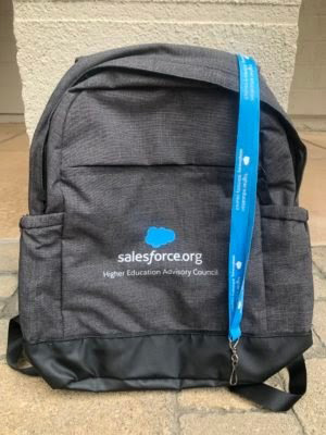 Salesforce.org backpack sitting on the ground