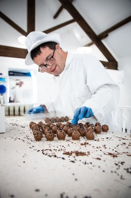 """Employee working at chocolate factory """" width=""""266"""" height=""""400"""" class="""
