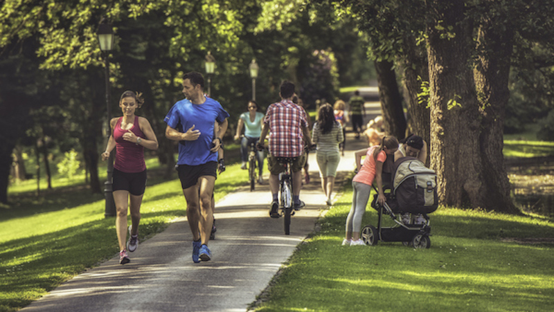 People walking and running in a park