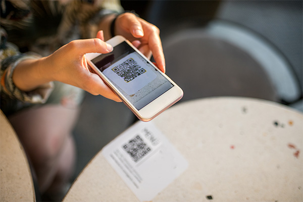 Person using QR code for mail
