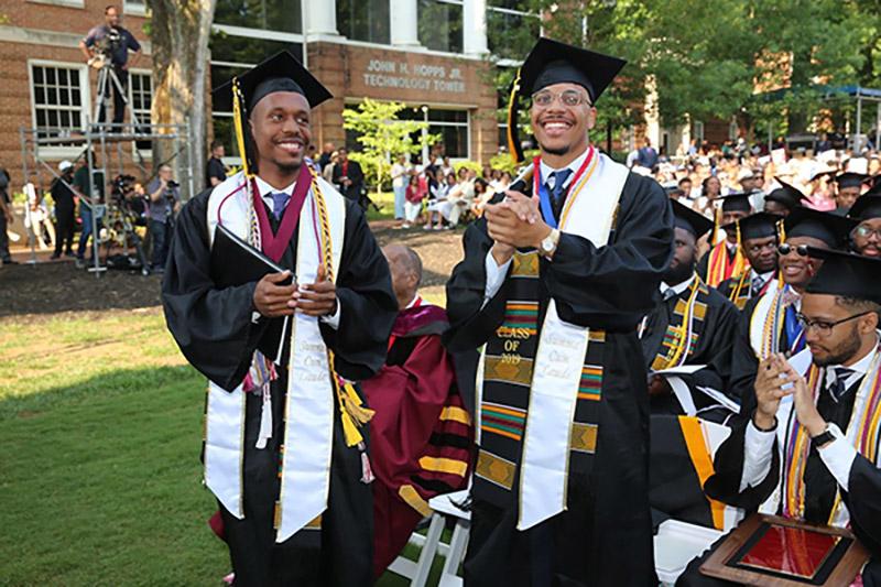 College graduates smiling
