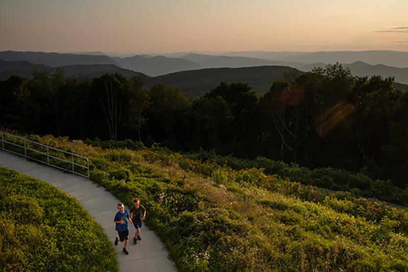 Kids run on a path above the High Knob overlook in Norton, Virginia.