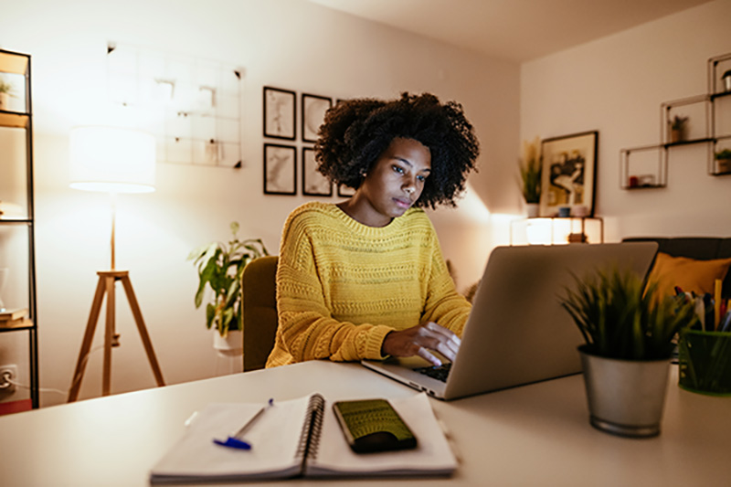 Woman sitting at computer working