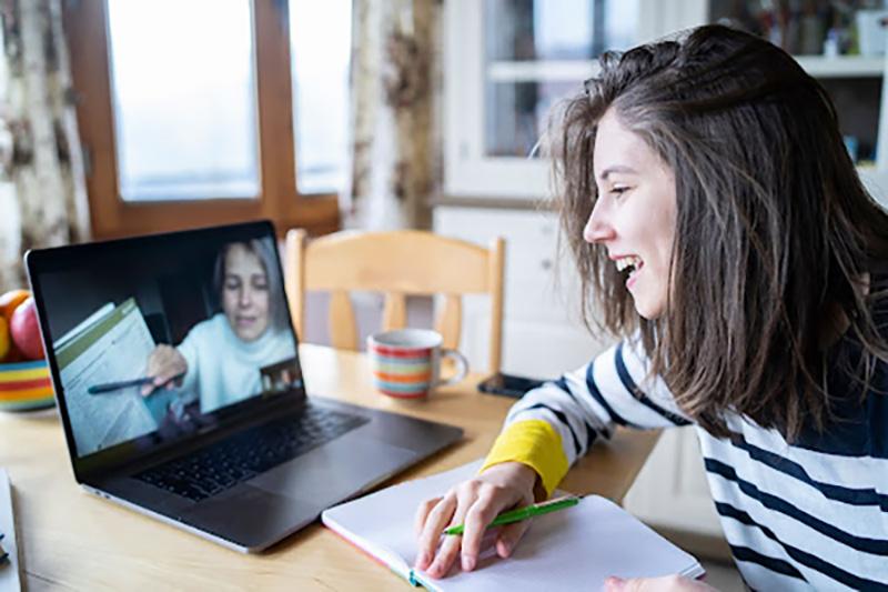 Woman smiling on virtual meeting