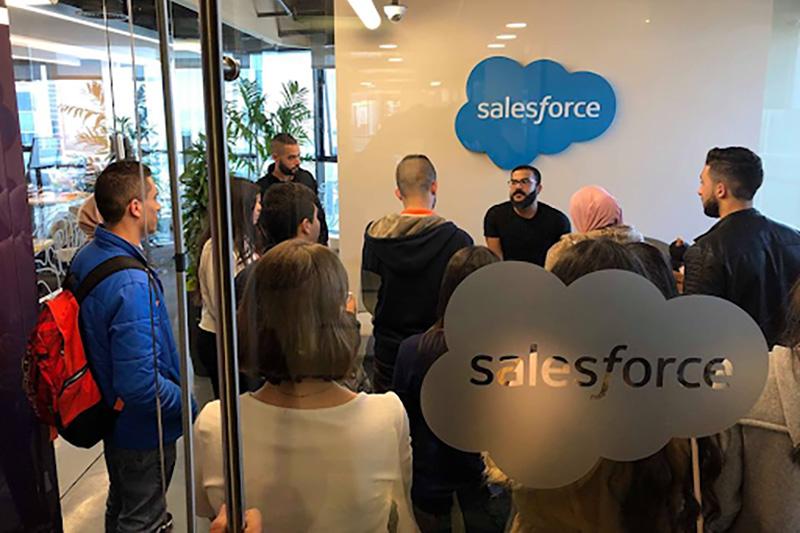 People standing in Salesforce office