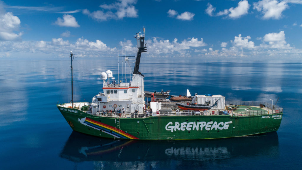 Greenpeace ship in the middle of the ocean.