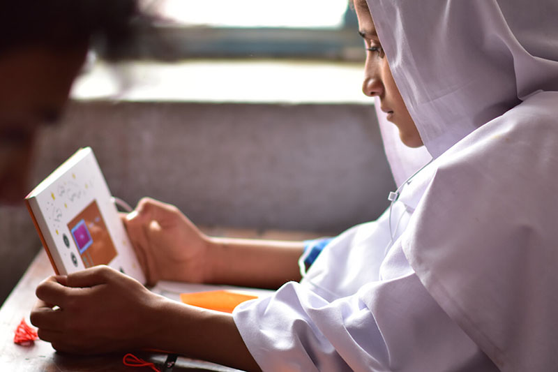Child learning using a tablet