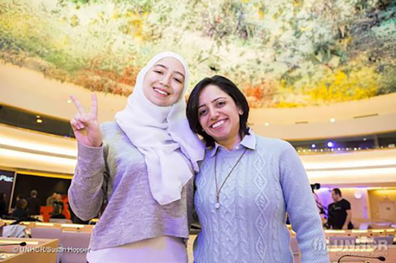 Two women posing and smiling at the camera